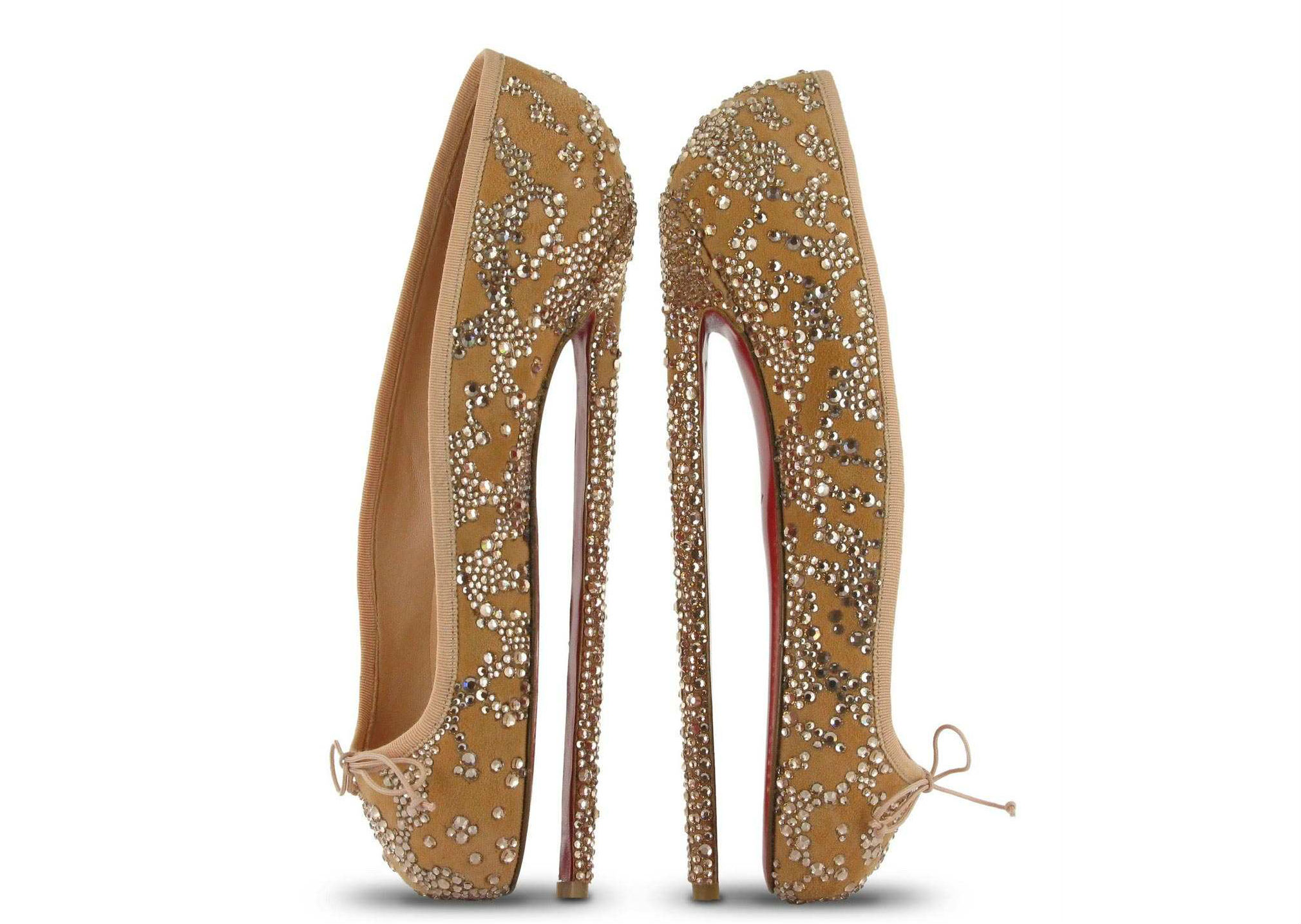10. It's hard to imagine that even real ballerinas could walk in this shoe. It's completely vertical and looks like more of a torture device than an elegant heel. We'd all probably cramp up every 5 minutes, or just break our foot.