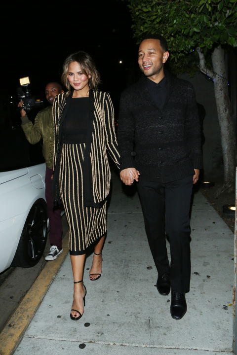 In a striped Balmain skirt suit while out to dinner with John Legend in LA.  SPLASH