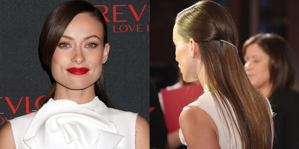 Who:Olivia Wilde  What:A Delicate Hair Accessory  How-To:Wilde added a dainty element of surprise to her asymmetrical hairstyle in the form of a bungee that held her hair flatly in place for a sleek, seamless flow down the back. For an invisible transition, match the bungee to your hair color.  Editor's Pick: Revlon Super Lustrous Lipstick in Certainly Red, $8, ulta.com .  GETTY