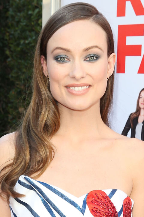 Who:Olivia Wilde  What:Sparkle Season  How-To:The best way to get into the holiday spirit (even in sunny Los Angeles) is with lots and lots of sparkle. Wilde demonstrated how to overload in a sophisticated, nuanced way by combining metallic striping with beaded embellishments and glittery blue-gray shadow that matched her eye color almost exactly and twinkled every time the light hit.  Editor's Pick: Revlon Photoready Eye Art in Cobalt Crystal, $10, ulta.com .  GETTY