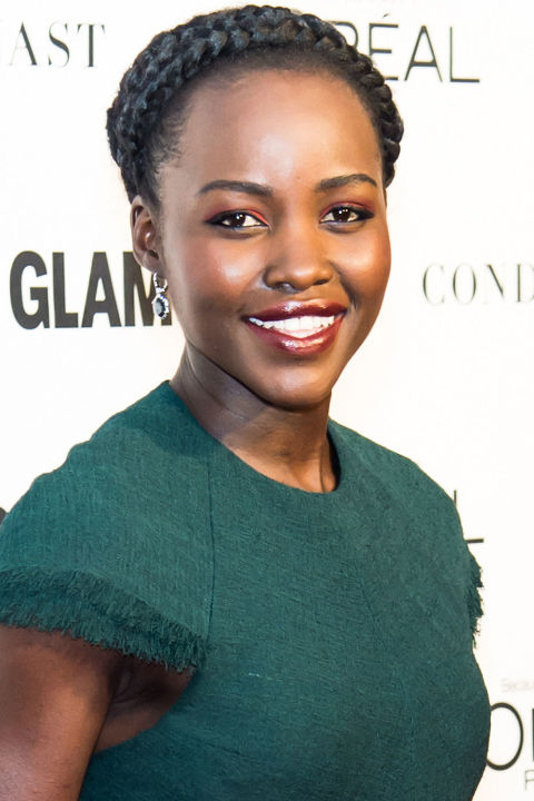 """Who:Lupita Nyong'o  What:Garnet Tones  How-To:""""Red eyeshadow is intimidating,"""" admits the actress's makeup artist Nick Barose,"""" but it's all in the color, texture and balance."""" Keep the boldest impact at the inner corners for a twist on traditional illuminator, then fade the shadow out to a soft wash across the lids and complement the eyes (without being too matchy-matchy) with a shimmery rust lip color."""