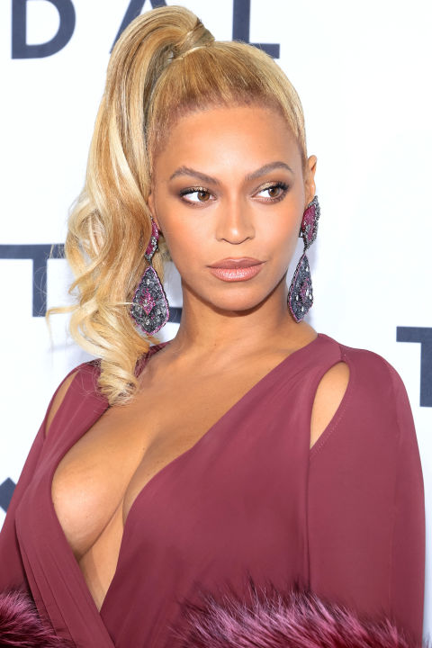 Who:Beyoncé  What:A Side Ponytail  How-To:It's common knowledge that Beyoncé doesn't follow trends, she starts them, and she's been loving high side ponytails since the Met Ball. The  I Dream of Jeannie style she favors popped up on the  Balmain Spring '16 runway and serves as a refreshingly energetic interruption in a season that's all about low, relaxed hair.  Editor's Pick: L'Oréal Paris Blow Dry It Thermal Smoother Cream, $5, drugstore.com .  GETTY