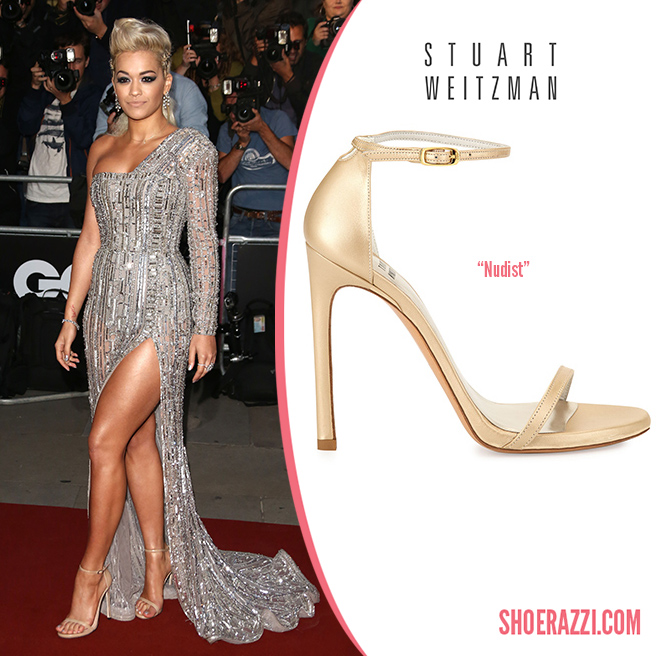 Credit: Lia Toby/Wenn   Rita Ora  wore  Stuart Weitzman   Nudist  sandals to the 2014 GQ Men of the Year Awards held at The Royal Opera House in London. These heels continue to be a  celebrity favorite  featuring nude patent leather, thin adjustable ankle-strap and 4.25″ heel.  Nudist  is available in silver glitter fabric at  Saks Fifth Avenue  plus in several styles at  Stuart Weitzman .   Outfit Details :    Zuhair Murad Fall 2014 Couture  art deco-inspired beaded one shoulder gown with a square neckline and high slit, plus deep sultry cat-eye makeup, a simple nude lip and diamonds from  Vashi Dominguez .  Check out more  shoes spotted on Rita .   Designer(s):   Stuart Weitzman ,  Style(s):   Sandals    Posted in:   Celebrity ,  Tag(s):   2014 GQ Men of the Year Awards ,  Ankle Strap , designer heel ,  Designer Shoes ,  London ,  Nude Leather ,  Nudist ,  Rita Ora ,  Sandal , shoerazzi ,  Stuart Weitzman ,  The Royal Opera House