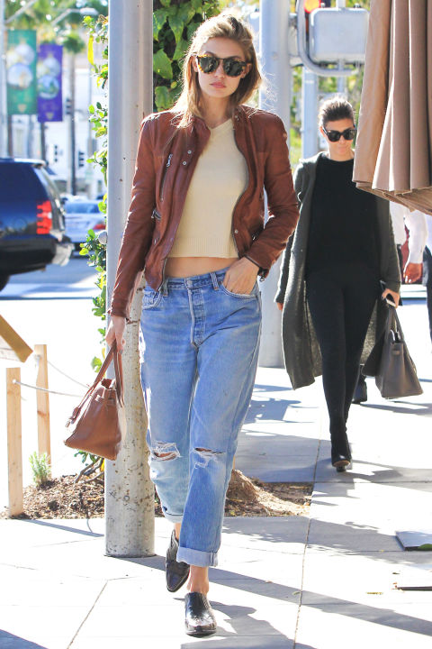 In a leather jacket, ripped boyfriend jeans and  Ganni western booties .  SPLASH