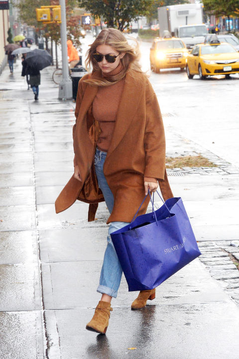 Hadid takes up the camel trend in an Everlane turtleneck on a rainy day in New York.  GETTY