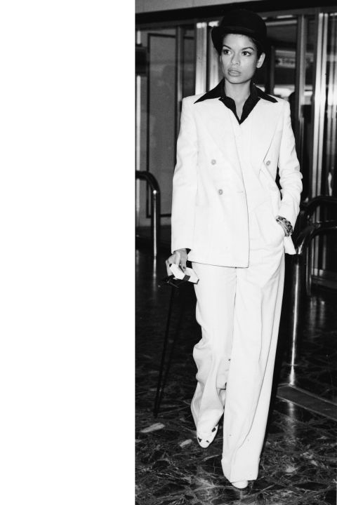 Bianca Jagger   Part of the high-glam '70s and a staple of Studio 54, Bianca Jagger had a style all her own. She favored sequined sheaths, fur, high-waisted pants, crisp suits, and blouses that were unbuttoned as could be. She mixed and matched old pieces with the new (think wide-legged pants with a revealing top, turban, and sleek, black choker) in a way that was thoroughly modern and entirely rock and roll.  GETTY