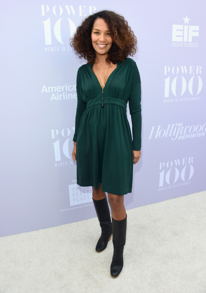 Mara Brock Akil let her natural beauty shine through in a green long-sleeve dress and knee-high boots.