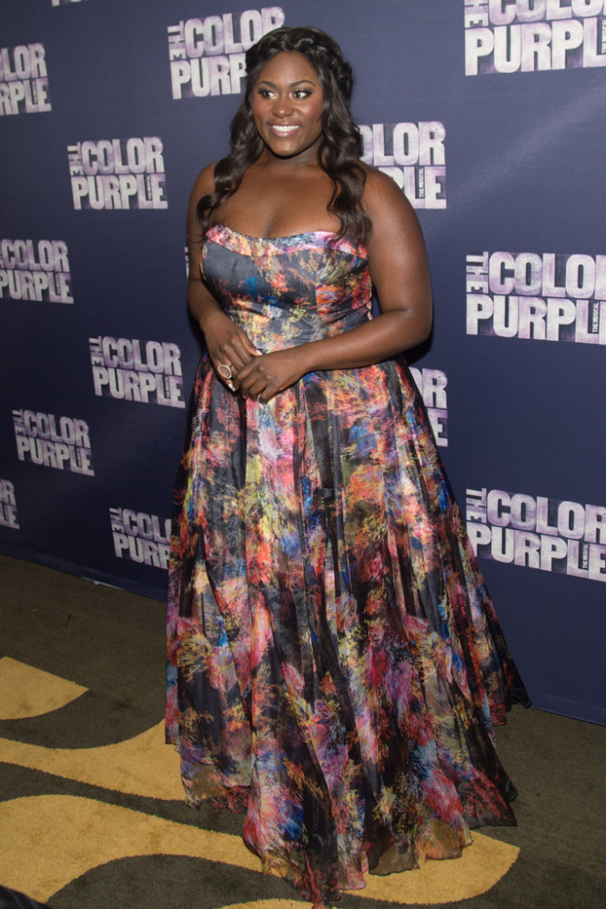Danielle Brooks looked ready for Spring in a strapless, floral print Jovani gown. One of her best looks of the year for sure.