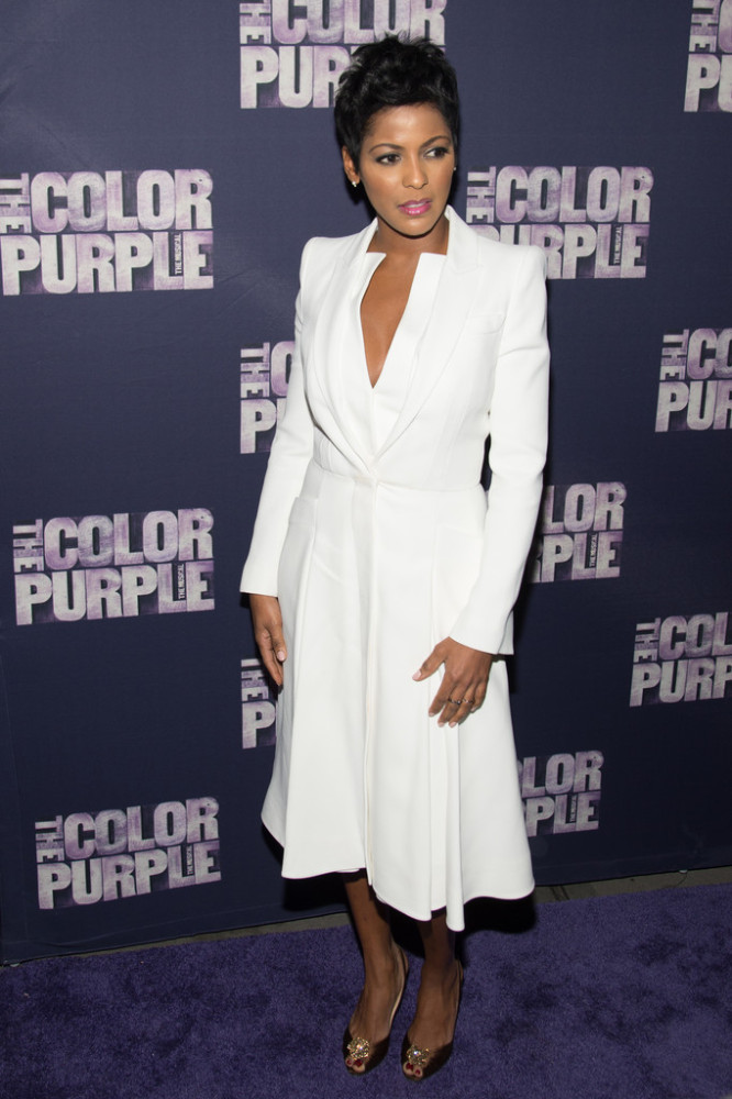 Tamron Hall was white hot in a chic dress with a plunging neckline, matching long coat, and gold peep-toe pumps.