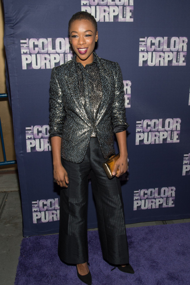 Samira Wiley was suited up for the evening in a glossy animal print blazer, matching button-front shirt, and black textured trousers.