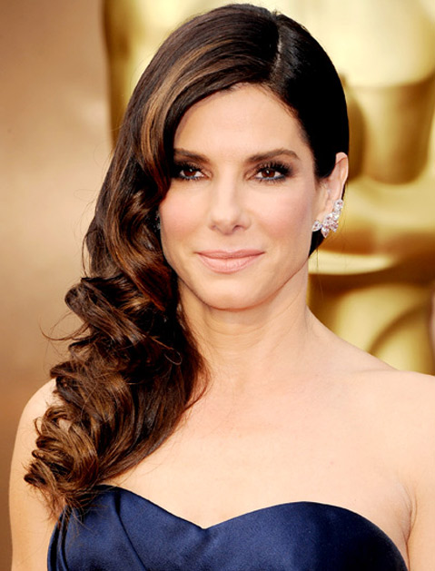 But these earrings don't all have to be clipped up high. Sandra Bullock opted for a low version.