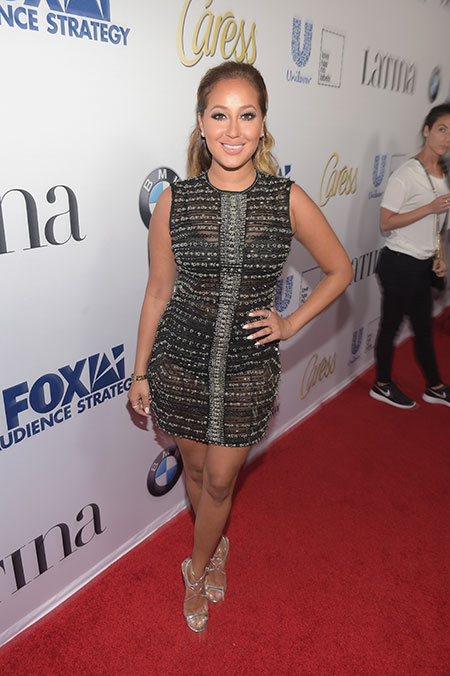 Our girl   Adrienne Bailon   kept it so  real  on the red carpet in this embellished LBD.