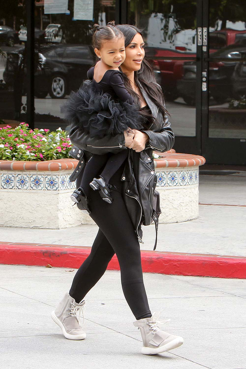 21 May 2015  Being carried by mum Kim Kardashian to ballet  Getty Images