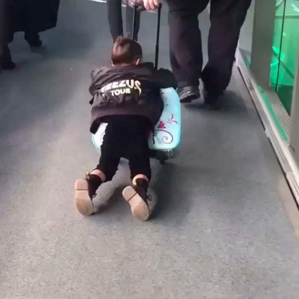 March 2015  Riding on her Frozen suitcase through the airport  @KimKardashian/Instagram