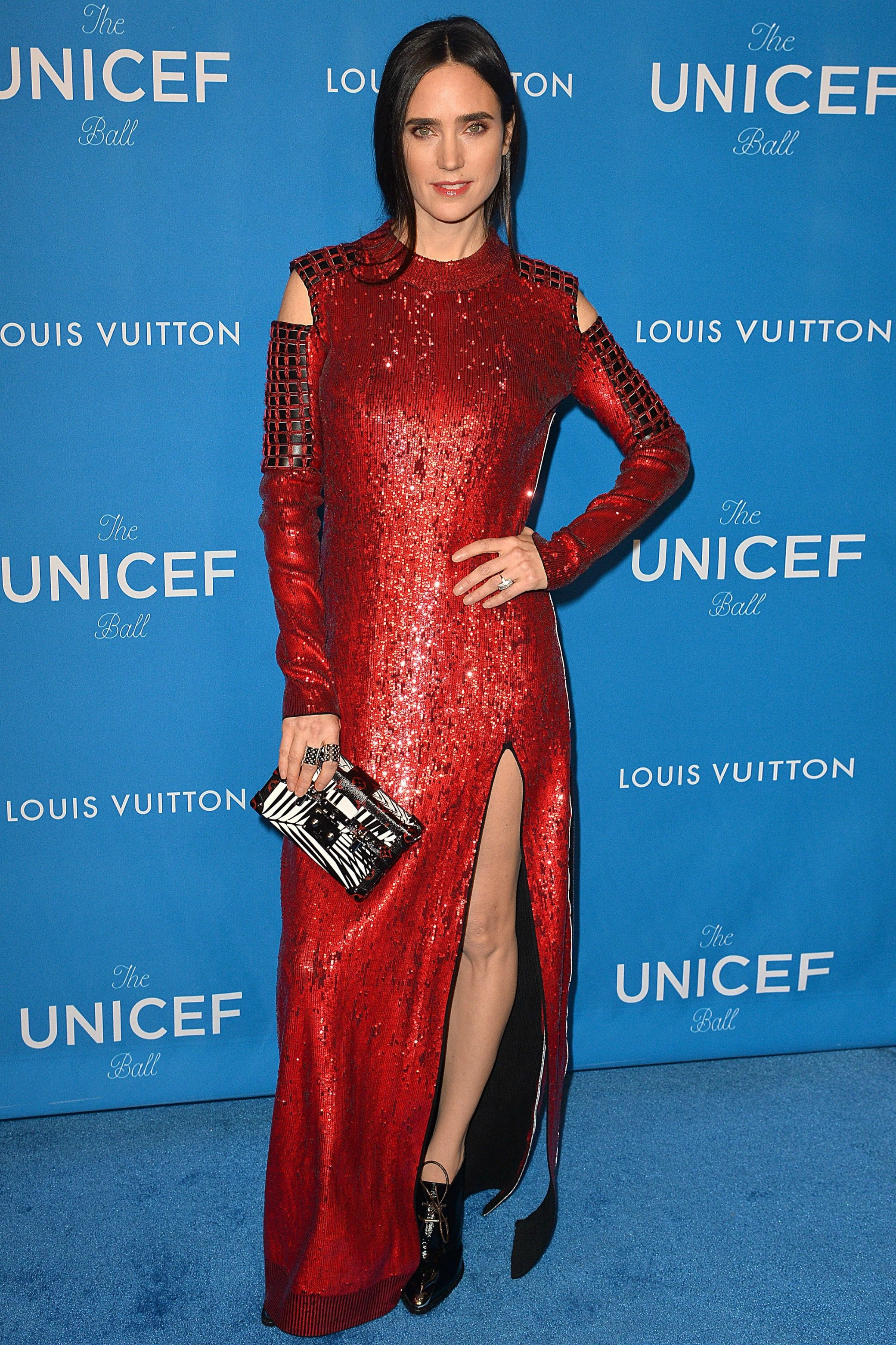 12 January  Jennifer Connelly's scarlet sequin dress featured cut-out shoulders and a thigh-high split