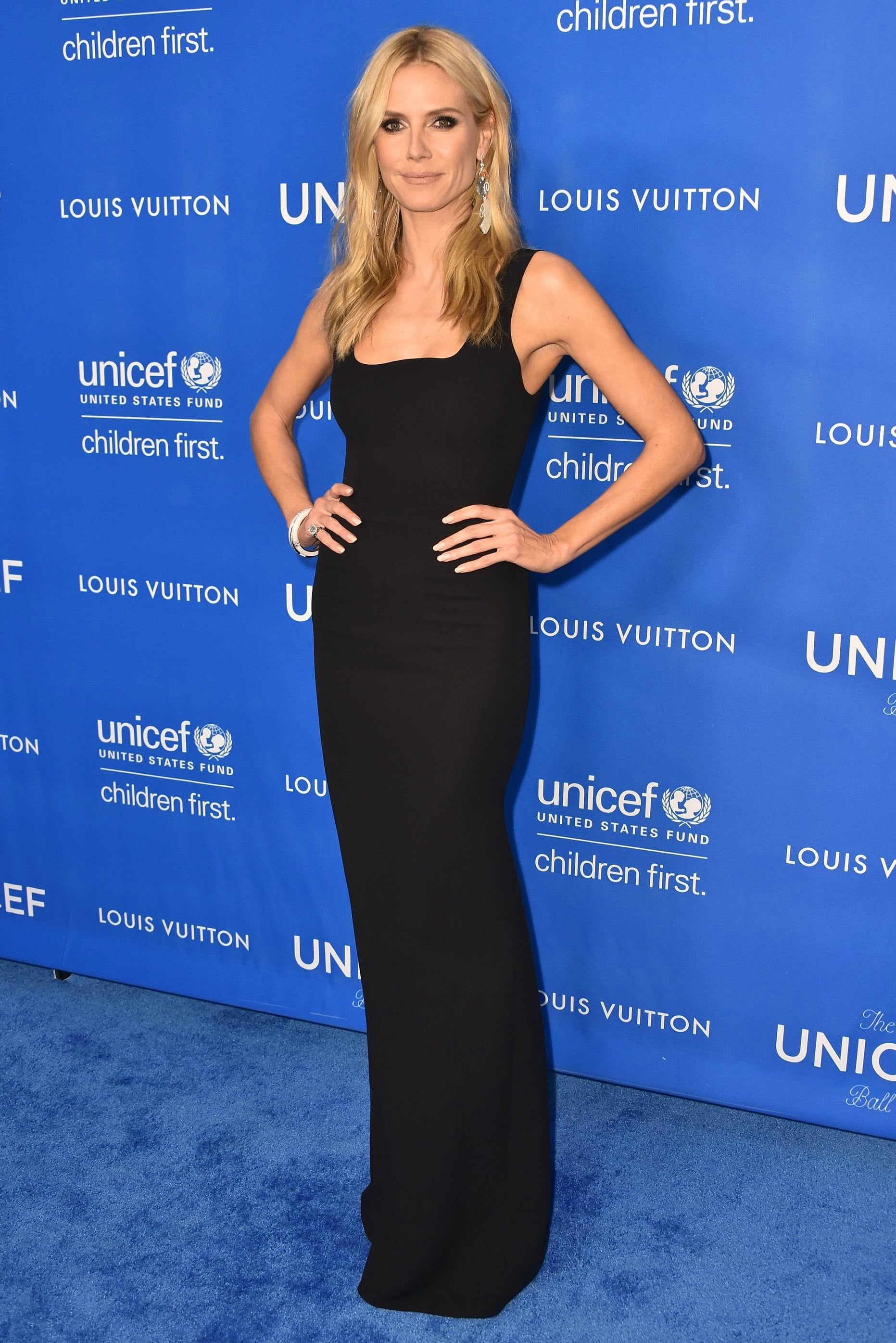 12 January  Heidi Klum kept her styling simple in a floor-length black dress