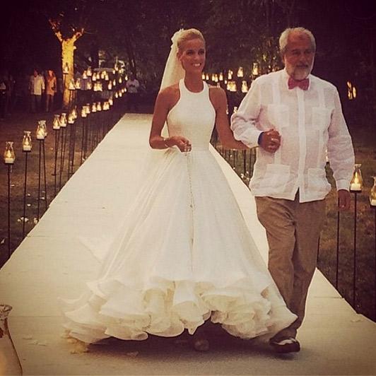 Carolina walking down the aisle with her father, Rolando. Photo: Mary Katrantzou/Instagram
