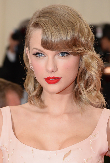 Taylor Swift  Throwing a vintage-inspired wedding? Channel Taylor's signature beauty look: a classic red lip paired with cateye liner.