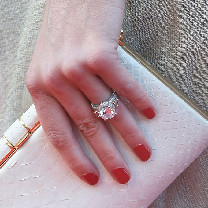 Amber Heard's Engagement Ring  Johnny Depp did well when he picked out wife  Amber Heard's round-cut diamond engagement ring . In fact, he liked it so much that  he sported the stunner on the red carpet when he announced their engagement !  Photo: Getty Images