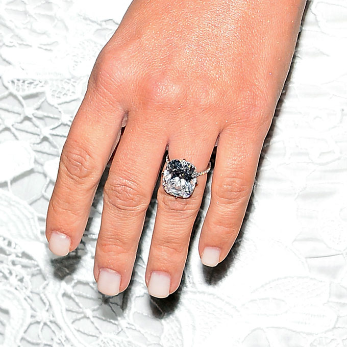 """Kim Kardashian's Engagement Ring  Like the rest of the world, we were captivated by the details of Kimye's big day, and months later we're still floored by her 15-carat engagement ring. West reportedly spent a cool $8 million to procure  the eye-popping cushion-cut diamond ring (and 33rd birthday present!). The D flawless type 2A rock (which jewelry designer Lorraine Schwartz described as a the """"perfect cushion-cut diamond"""") is set in a pavé band so delicate, it looks as though the diamond is floating on air.  Photo: Getty Images"""