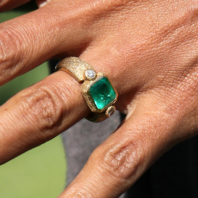 Halle Berry's Engagement Ring  Set in a textured, hand-forged, yellow-gold setting, the ring's four-carat emerald — sourced from Colombia — is flawless in color and flanked by two diamonds. Berry's husband Olivier Martinez commissioned the one-of-a-kind piece from his Paris neighbor, jeweler Robert Mazlo. The ring reportedly contains codes and symbols in lieu of an inscription, which only its wearer can understand.  Photo: Getty Images