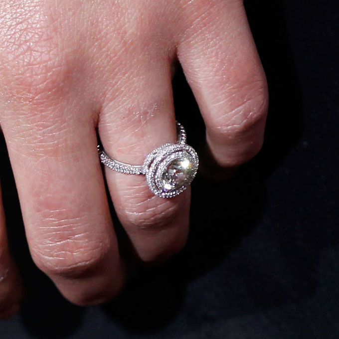 """Natalie Portman's Engagement Ring  The actress wears a round-cut diamond ring encircled by a """"halo"""" of pavé diamonds by  Jamie Wolf .  Photo: Michael Buckner/Getty Images"""