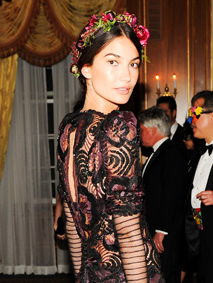 FLOWERS   Flowers in the hair: groundbreaking, right? Well, actually, yes. Skip the daisy crowns and go for oversize blooms or a scattering of tiny rosebuds. The key is to keep the hair loose and tousled; the flowers are almost all the styling you need. Lily Aldridge is wearing a crown by Stone Fox Bride.