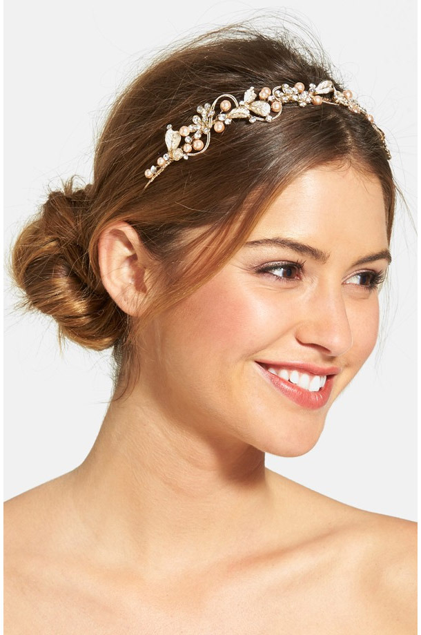 Wedding Belles New York Bead & Crystal Headband ($165,  nordstrom.com )  The pearly glass beads on this headband add a touch of contrasting color that looks especially pretty against darker hair colors.     Read more:  http://dailymakeover.com/wedding-headpieces/#ixzz3oClIcnRF