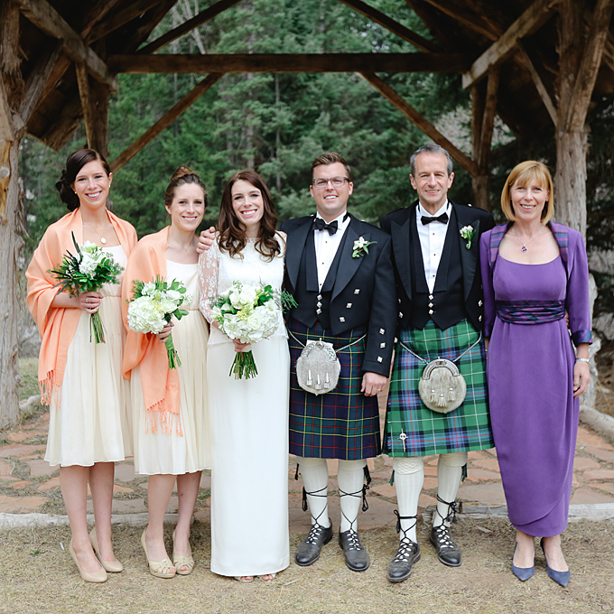 Karine and Carl's remote wedding in the Colorado Rockies featured refined rustic details, fur shrugs and kilts for all male guests. Karine's mother celebrated the romantic mountainside wedding in a purple gown with tartan detailing to match the kilts.    See more purple mother-of-the-bride dresses.      View more photos from Karine and Carl's wedding.    Photo:  Laura Murray Photography