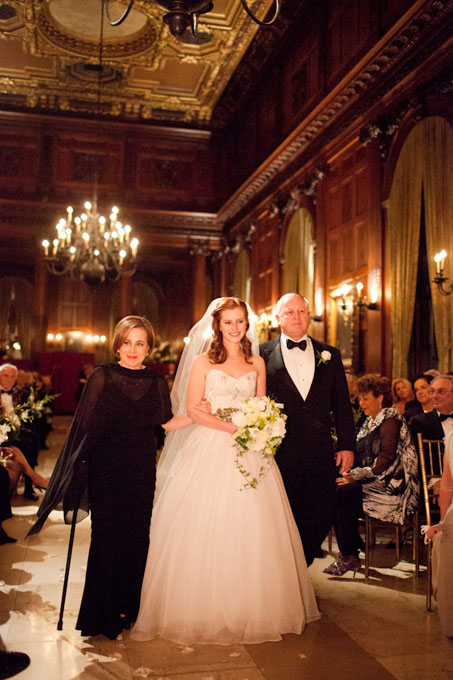 Sarah and Scott held a timeless fall wedding at the opulent University Club in New York City. Sarah's mother's formal black dress received dramatic flair from the accompanying sheer shawl.    See more black mother-of-the-bride dresses.      View more photos from Sarah and Scott's wedding.    Photo: Jason Walker and Shannen Norman of  Ira Lippke Studios