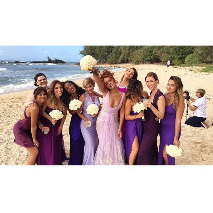 """When the ultimate Bad Gal is your bridesmaid, BFF, and boss, you know you're in for a good time at your wedding. The  superstar posted photos of her pal Jennifer Rosales's Hawaiian wedding day , which featured Rihanna herself in a stunning lilac Badgley Mischka gown. The only thing better than her curve-hugging bridesmaid dress? The """"bridesmaid"""" and """"bride"""" robes the whole party donned before the Rastafarian-themed bash.  Photo: Rihanna via  Instagram"""
