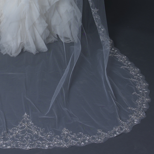"Stunning scalloped cathedral length bridal wedding veil accented with pale silver floral embroidery embellished with seed beads and rhinestones.    Length: 108"" inch long x 71"" inch wide"