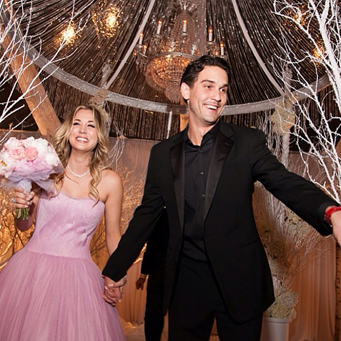 Photo: Kaley Cuoco Sweeting via   Instagram    Kaley Cuoco Sweeting   The  custom pink Vera Wang confection  that the  Big Bang Theory  star wore to marry Ryan Sweeting at their New Year's Eve wedding strongly evoked  Wang's Fall 2014 runway collection , which she designed in shades of pink. Cuoco donned the strapless tulle ball gown with a sweetheart neckline for the ceremony before changing into a shorter red dress for the reception.