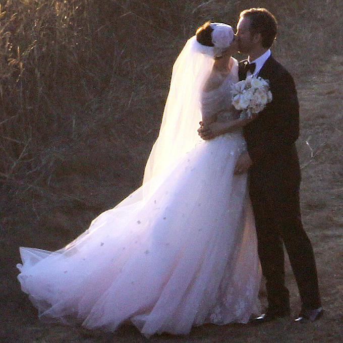 Photo: Getty Images    Anne Hathaway   Valentino Garavani came out of retirement to design his muse's  wedding dress for her September 2012 wedding to Adam Schulman . The gown featured a gauzy, tulle overskirt and an elegant off-the-shoulder-neckline fashioned from the same fabric, all imbued with shades of blush pink. The dress, plus her lacy headpiece, created a dazzlingly romantic and whimsical look.