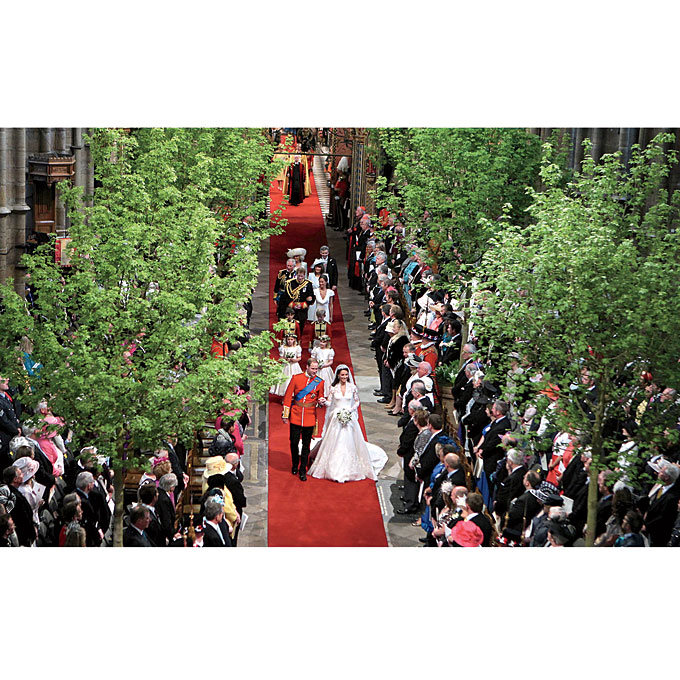 """Photo: Getty Images   The Décor  Kate originally wanted a country wedding but compromised by giving Westminster Abbey a woodsy feel, with eight 20-foot trees sourced from the royal estates. """"The day after, the phones started ringing with brides asking for trees,"""" says O'Brien. """"They add warmth and elegance."""" New York floral designer Frank Alexander has noticed the same trend: """"We're incorporating more tall greenery into the aisle decor."""""""