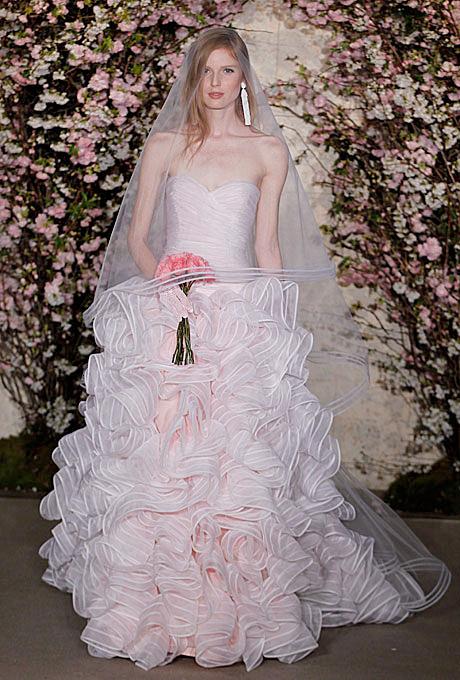 Oscar de la Renta   Gown by  Oscar de la Renta     Browse more Oscar de la Renta wedding dresses.   Photo: George Chinsee