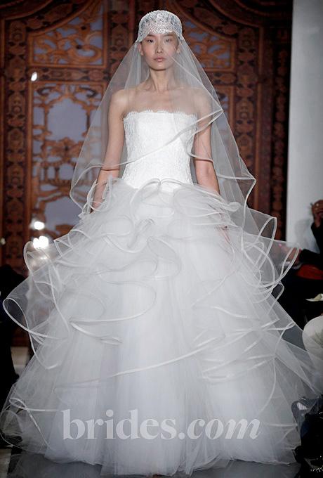 Reem Acra   Gown by  Reem Acra     Browse more Reem Acra wedding dresses.   Photo: John Aquino