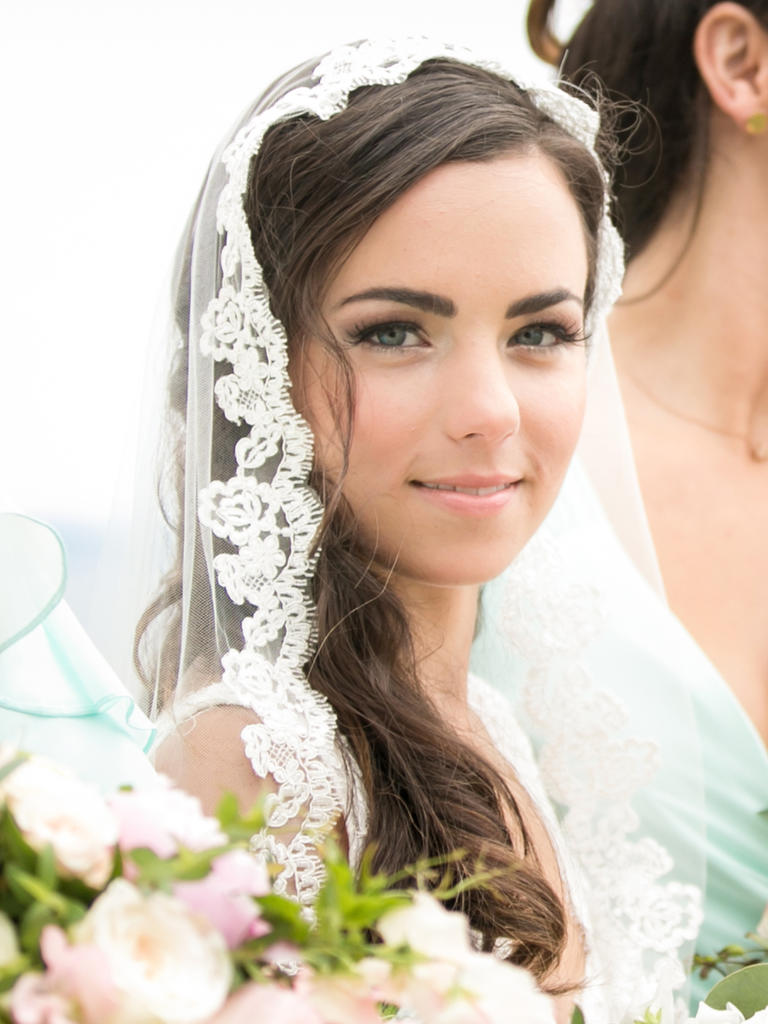 PHOTO BY MELANI LUST PHOTOGRAPHY  Is it just us or is this bride channeling Kate Middleton? Whatever the inspiration, her bold brows, barely there pink lip and understated eye shadow elevate this newlywed to princess status.  From the album  A Romantic Vineyard Wedding at Jonathan Edwards Winery in North Stonington, Connecticut