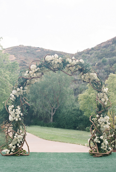 A classic arch of intertwining branches, hydrangeas, and roses.  Photo:  Diana McGregor Photography