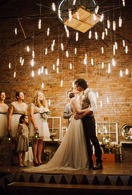 An urban ceremony altar with hanging edison bulb chandelier.  Photo:  Jac and Heath Photography