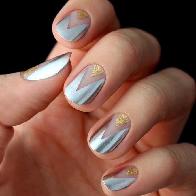 A geometric gold-and-silver manicure.  Photo: LuLu's via  Instagram