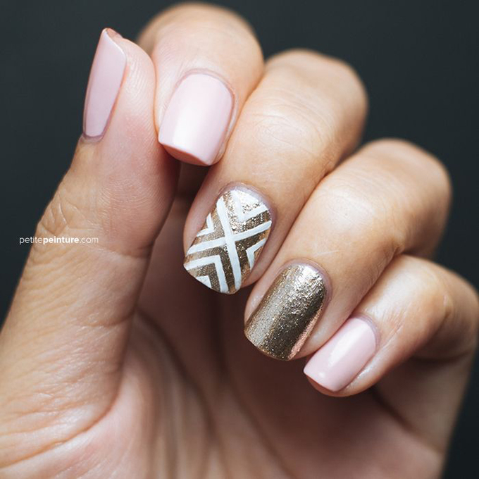 A pink-and-gold manicure with a patterned accent nail.  Photo: Courtesy of  Petite Peinture