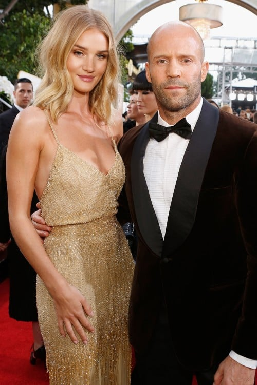Getty Images     Rosie Huntington-Whiteley  and Jason Statham are engaged.    The pair made the subtle announcement on the  Golden Globes red carpet last night , when the 28-year-old model was pictured wearing a diamond ring on her engagement finger. The couple's representative later confirmed the news to E! Online.