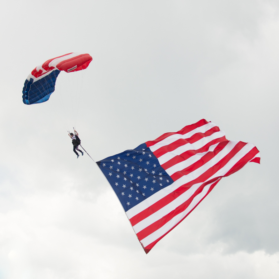 Patriotic para-jumpers kept the Memorial Day crowds mesmerized along with a fighter jet flyover by the Air Force.