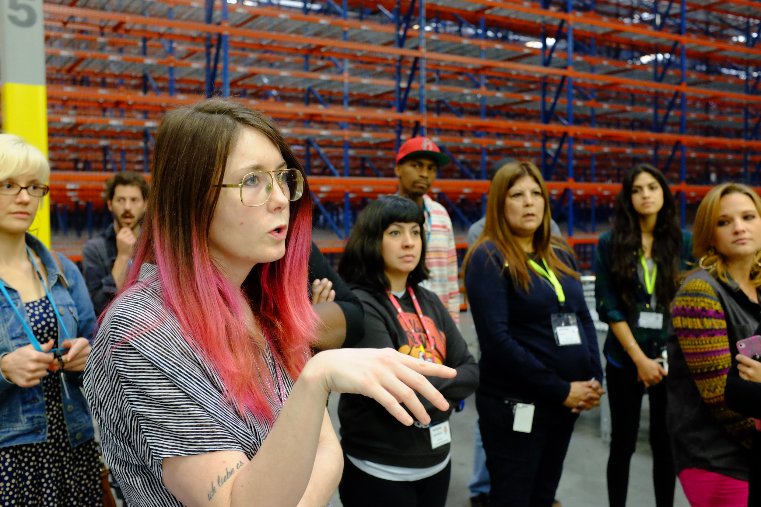 Lindsay asks a question during the fulfillment center tour.
