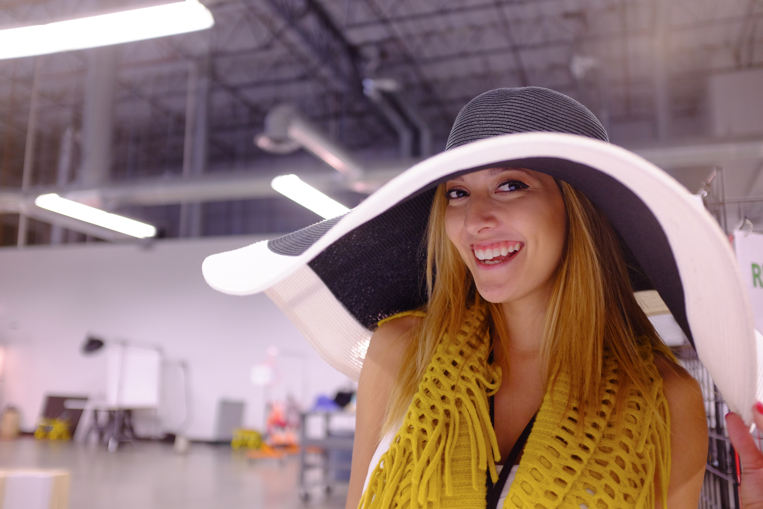 Product stylist Dani models this big floppy hat that we had in the studio this week. This one was the biggest, but there were others that came close.