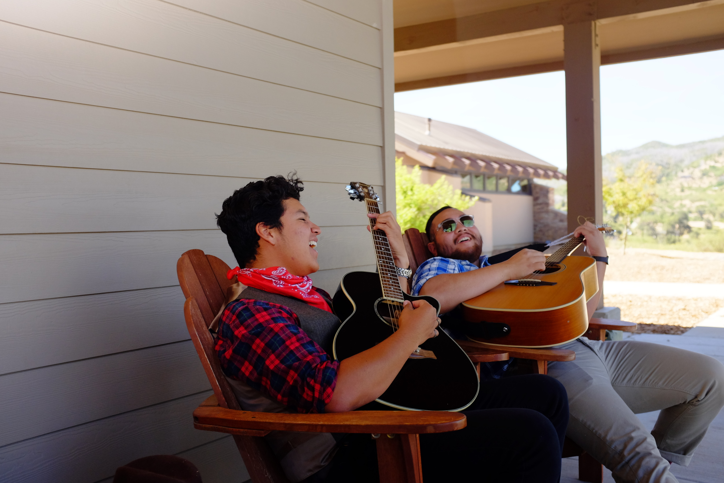 Musicians Angel and Matthew relax on the patio and play some music