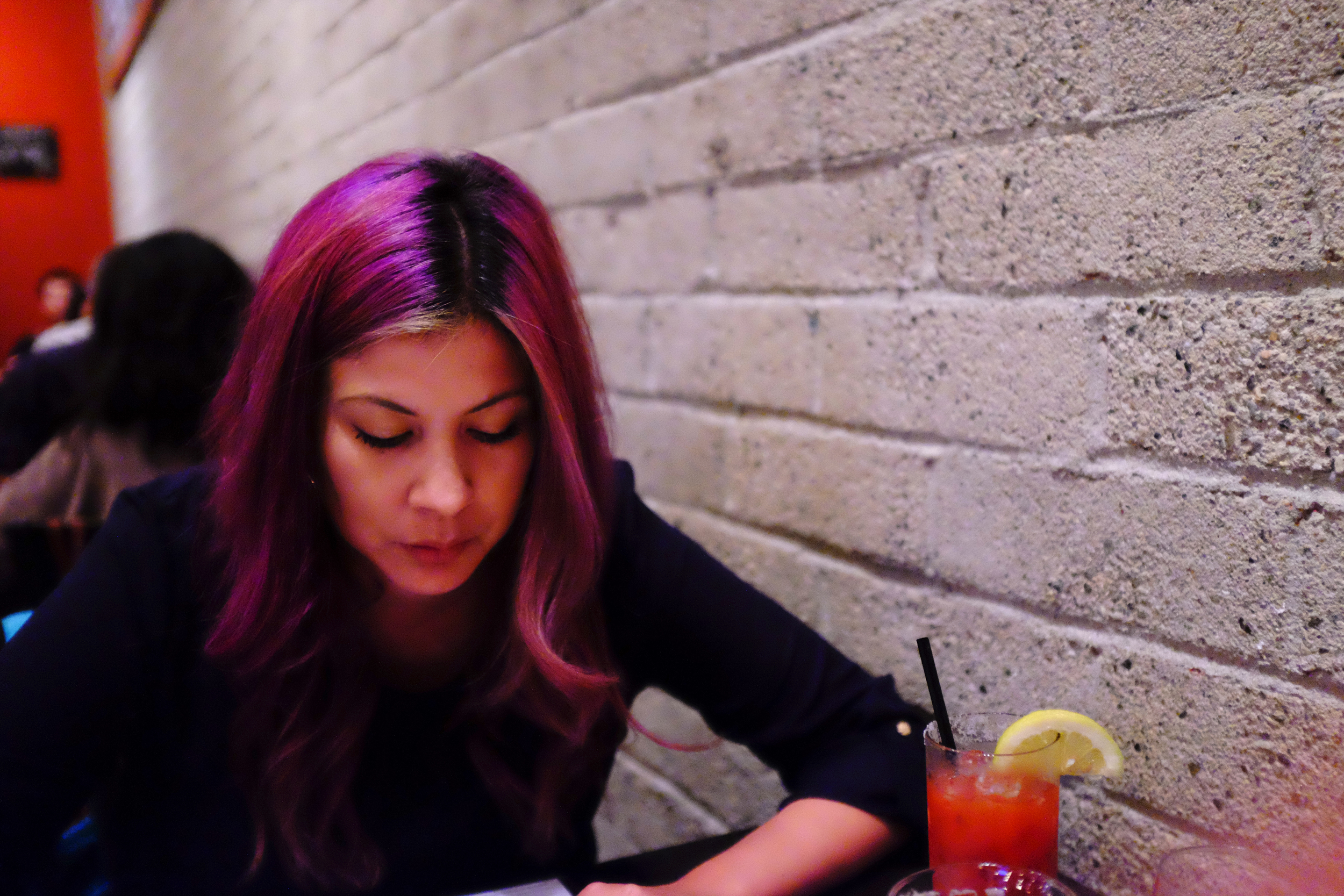 My gorgeous wife at dinner for our 7th Anniversary. Super low light portrait manual focused with the Fuji x100s.