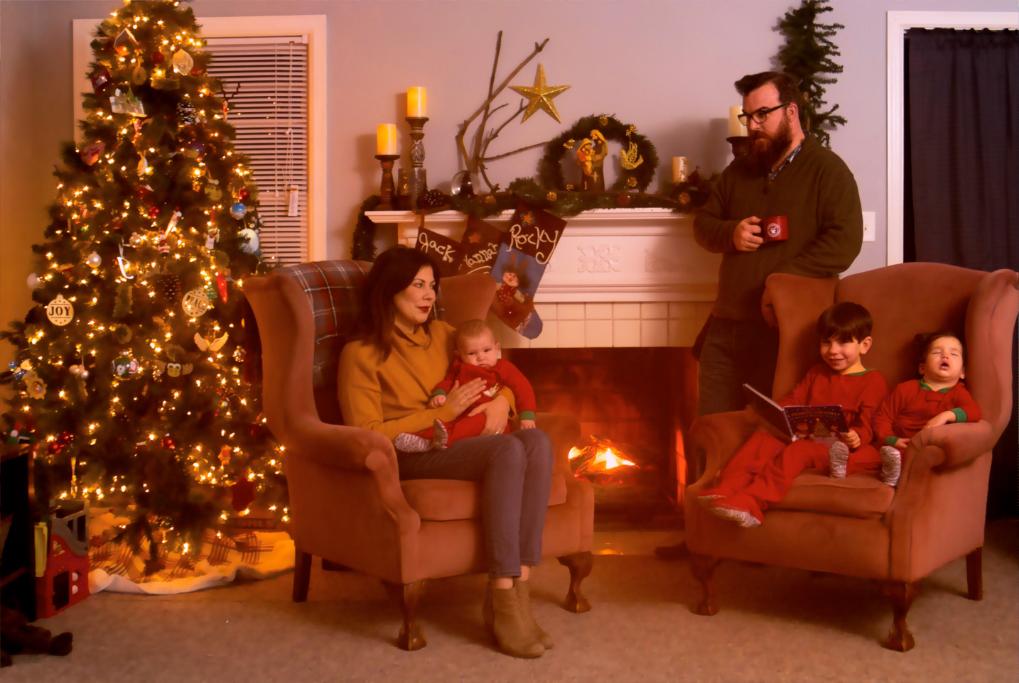 This family Christmas portrait took tremendous planning and testing, all of which was done before the kids ever got in the shot. Even so, we still had to just put Hannah to bed and then bring her out while asleep. Sometimes they just don't want to cooperate.