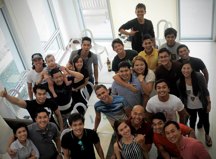 The PKPH Family during Xmas 2013 consisting of the current core volunteers, alumni and community members. Ira Villar is wearing the collared-shirt with horizontal stripes while slightly on his right and below wearing a white shirt is Derek Sta Ana.